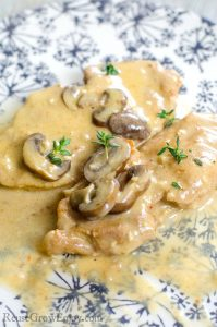 Pressure Cooker Pork Chops on a plate With Mushroom Gravy