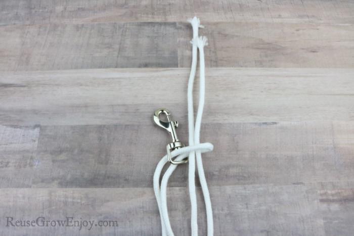 Pull ends through loop on hook