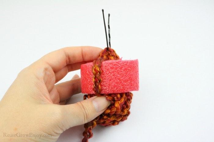 Pull yarn through noodle