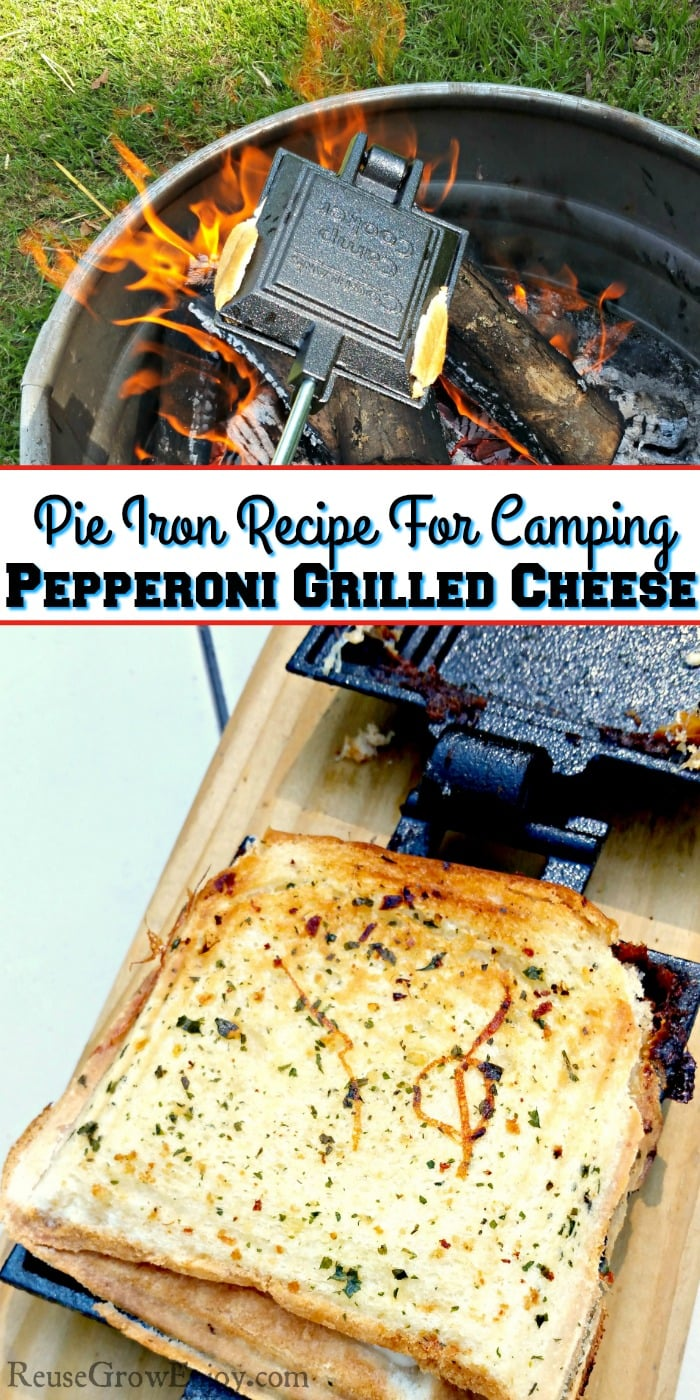 Grilled cheese in pie iron laying on wood board. Campfire with pie iron cooking over in background. Text overlay in the middle that says Pie Iron Recipe For Camping - Pepperoni Grilled Cheese.