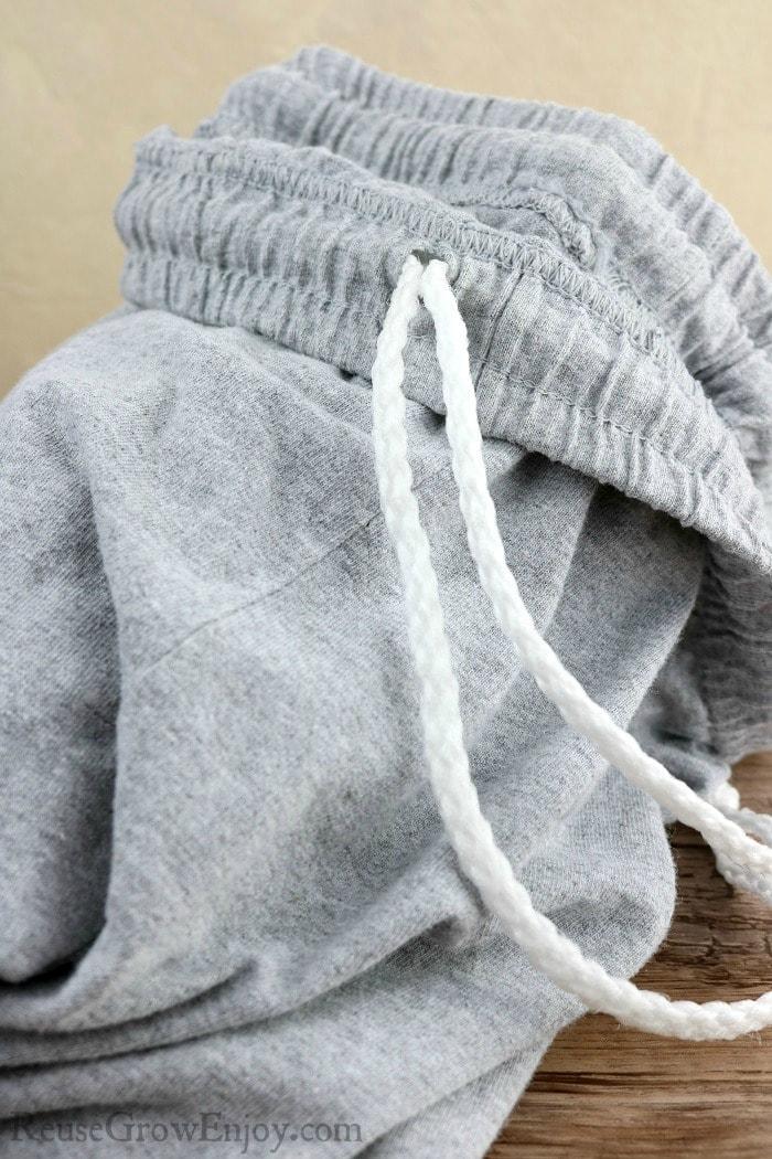 Thread drawstring through shorts to make them new again.