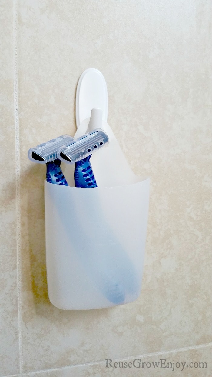 Don' toss out that empty shampoo bottle! You can use it or other empty plastic bottles to make handy holders and vases to use around the house!