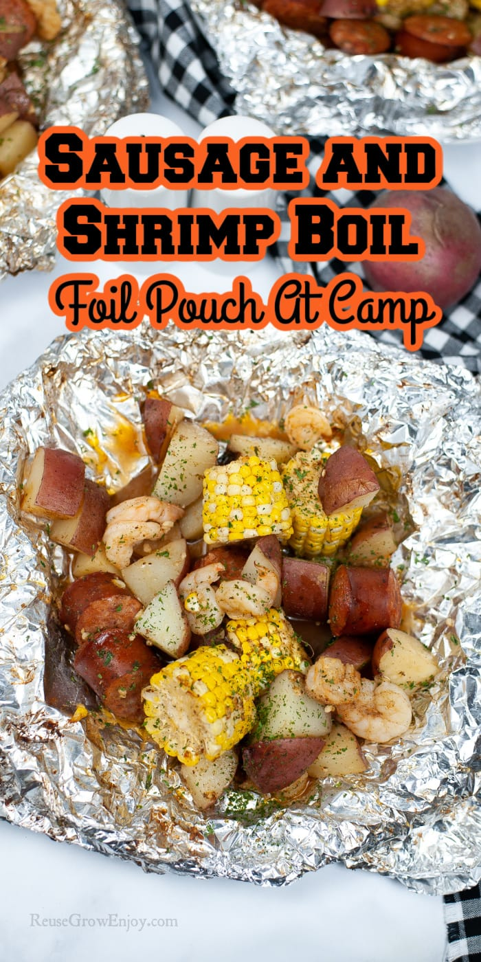 Shrimp Boil Foil Pouch Dinner opened up on table with two more in background text overlay at the topd