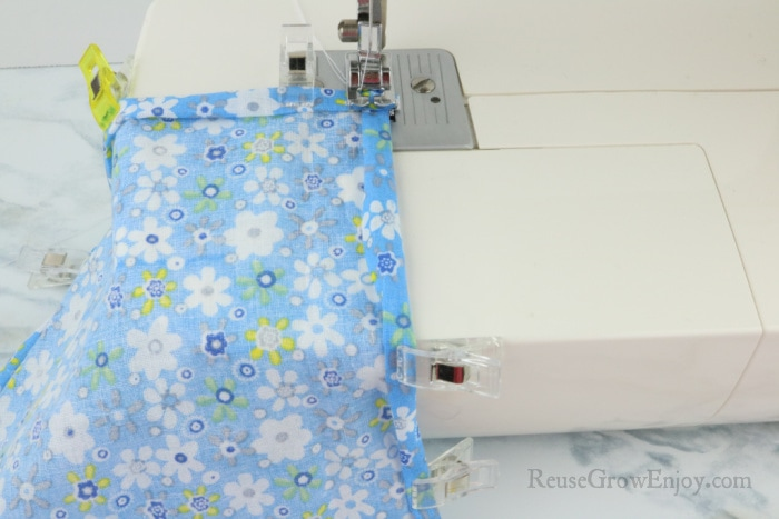 Sew down edges of fabric