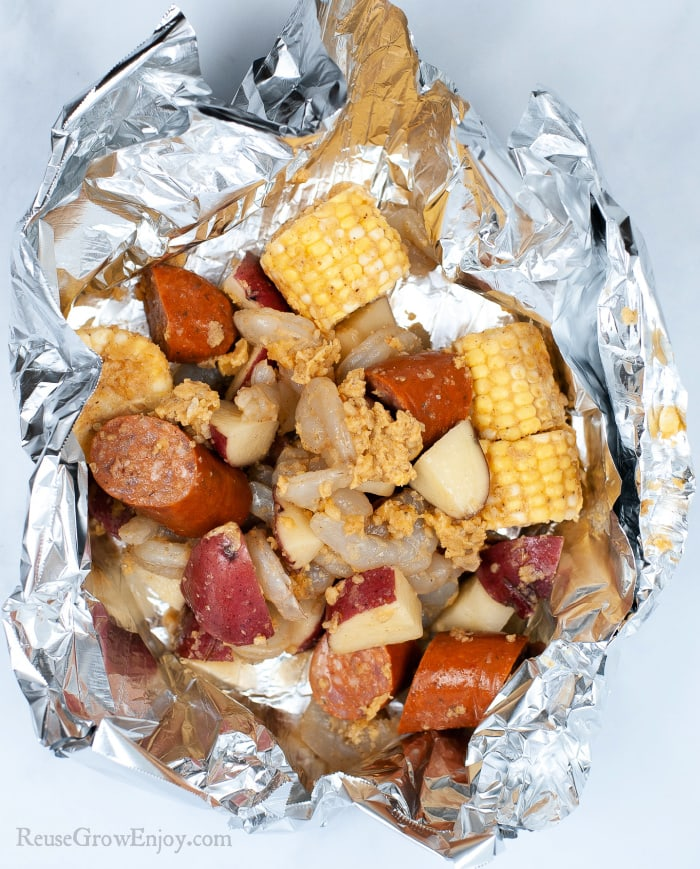 Shrimp boil added to foil to make a pouch