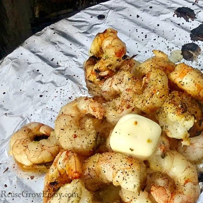 Campfire shrimp cooking on foil