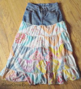 DO your kids have some clothing that they love but are to big to fit anymore? Check out this Upcycled Jeans And Sundress Into Skirt!