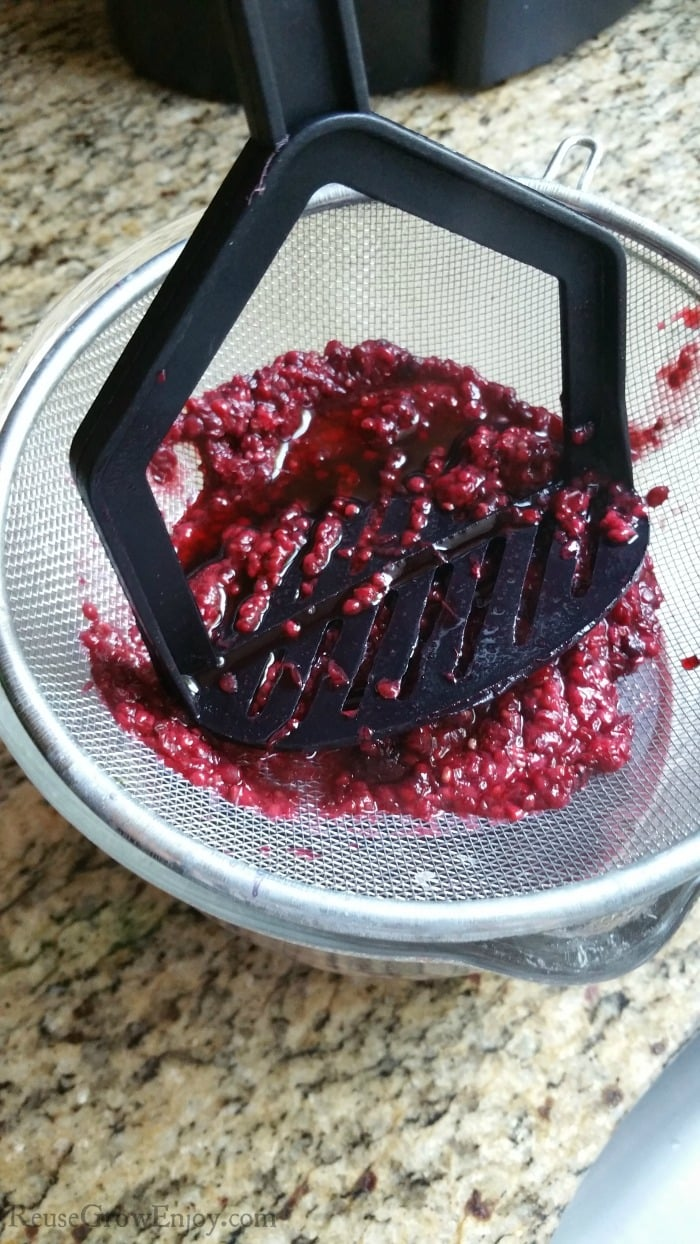 Smash berry mix on strainer