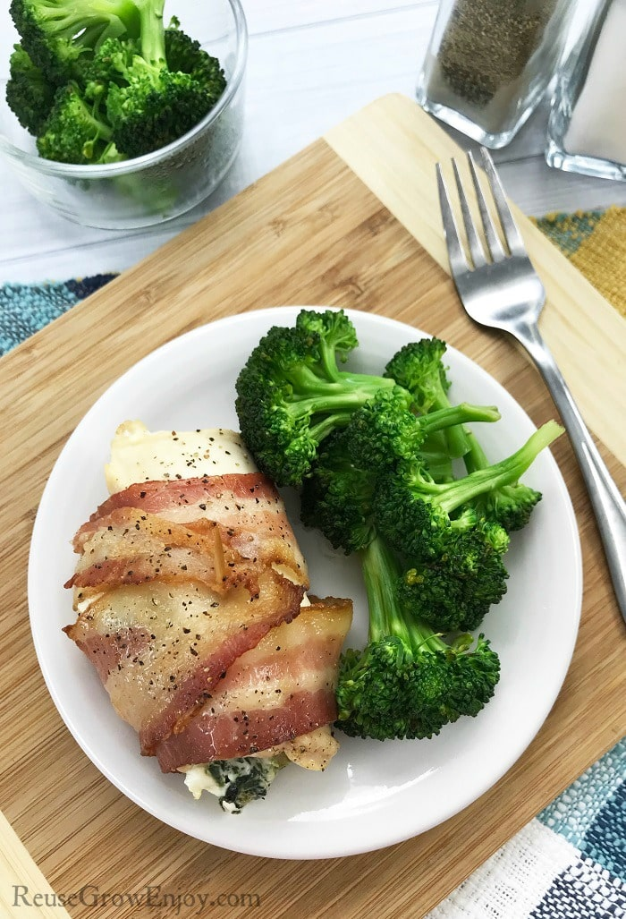 Are you on a low carb or Keto diet? If you are looking for a delicious recipe, check out this easy Spinach & Cream Cheese Keto Bacon Wrapped Chicken Recipe!