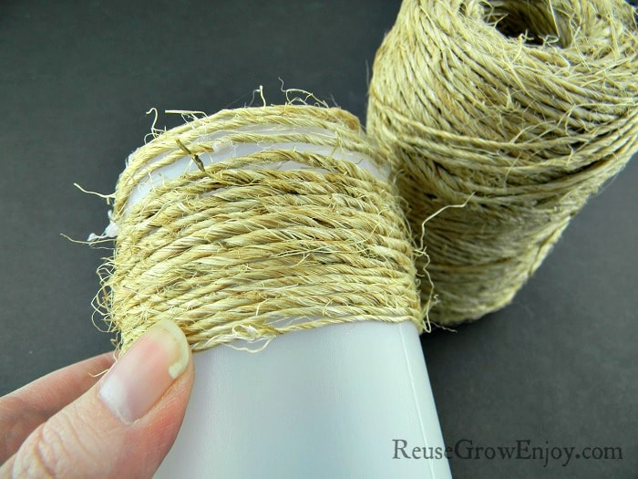 Twine wrapped about half way down a small plastic bottle