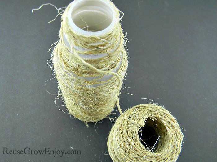 Twine wrapped all the way from one end of the plastic bottle to the other end