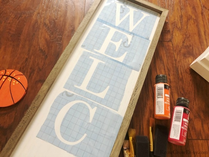 Stick letters to board