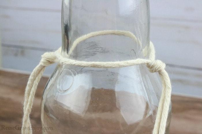 Tie string to bottle neck