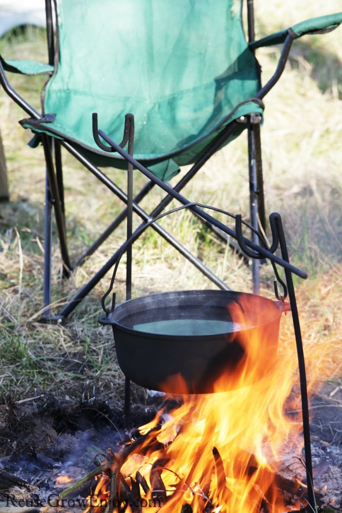 Folding chair by campfire with dutch oven