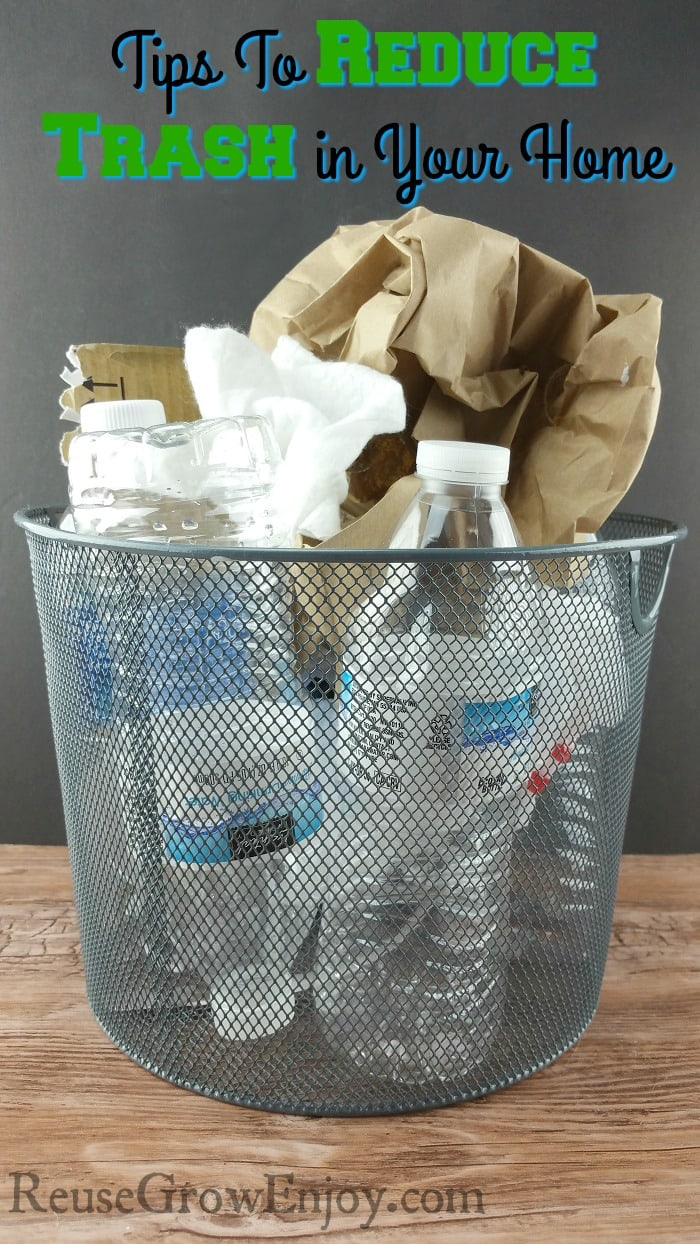 Small wastebasket full for things like plastic bottles and bags and other trash