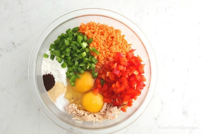 Tuna Cake Ingredients in a clear glass bowl.