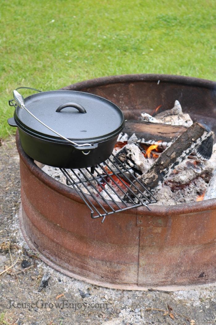 Turn dutch oven around fire