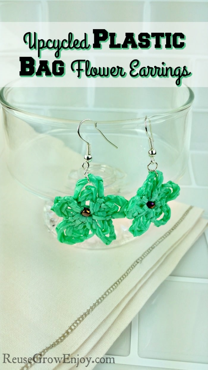 Are someone that likes to do crafts? If that sounds like you, I have a fun and super cute project for you. You can make these Upcycled Plastic Bag Flower Earrings!