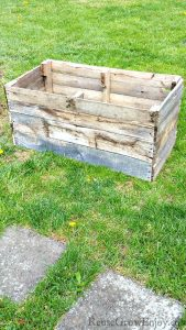 Need some extra growing space this garden season? If you have a pallet, here is a project you can do. I am going to show you step by step how to make this Wood Pallet DIY Raised Planter Box!