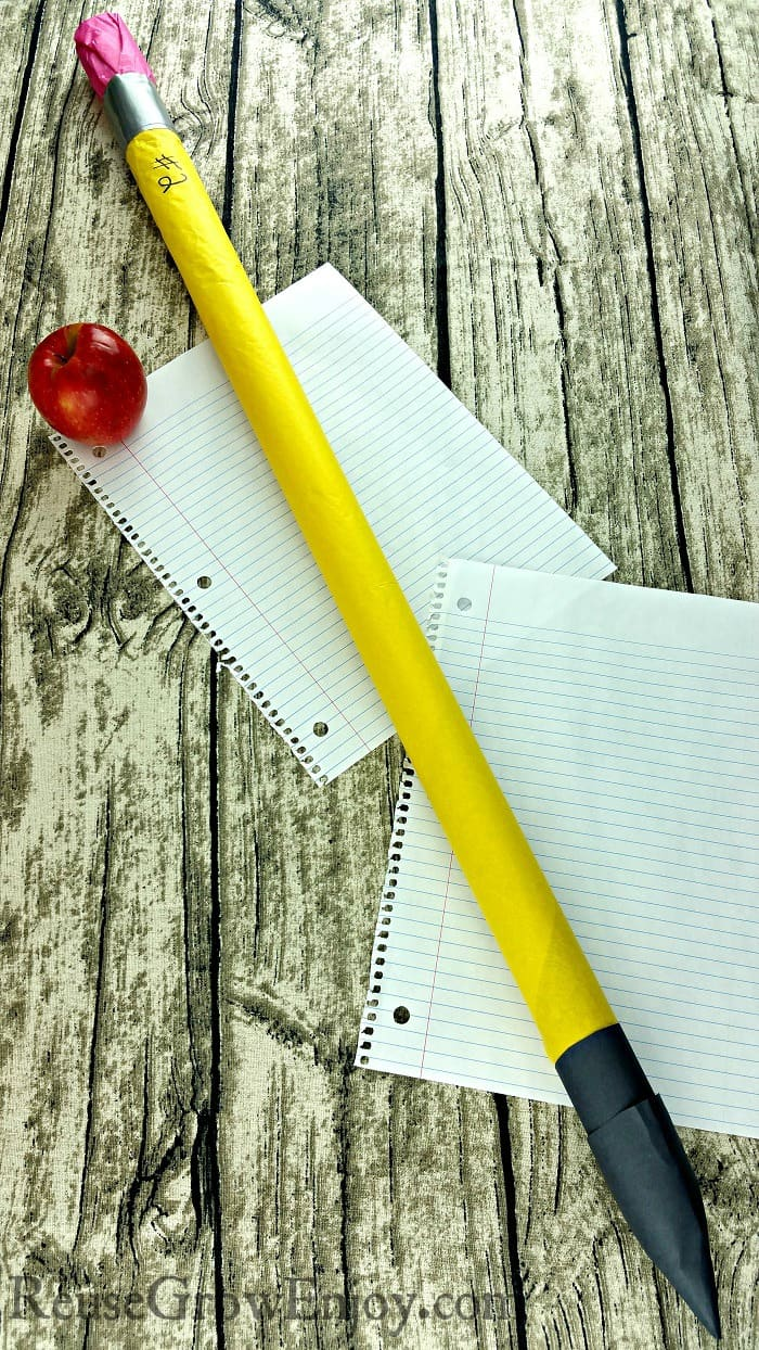 Looking for a fun craft to do with the kids? Check out this upcycled cardboard tube giant pencil.