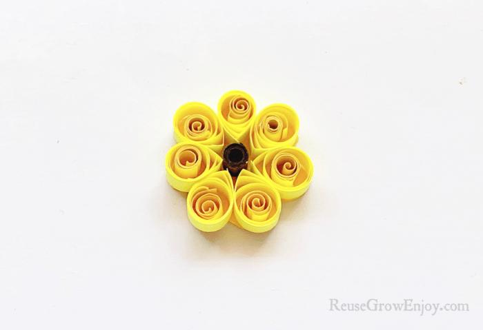 Yellow paper trimmed around around the petals