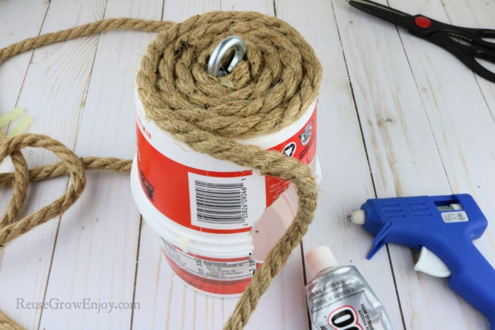 coil the rope around to cover the bottom